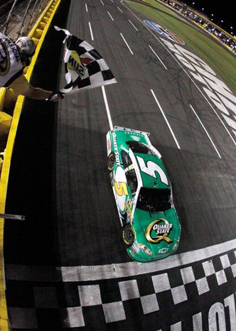 Kasey Kahne took the checkered flag in the Coca-Cola 600 on Sunday night to continue Hendrick Motorsports dominance. (Associated Press)