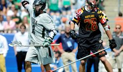 Loyola's Eric Lusby, the tournament's most outstanding player, celebrates a fourth-quarter goal. Lusby scored 17 goals in four tournament games to break the record of 16 shared by Virginia's Matt Ward (2006) and Duke's Zack Greer (2007). (Associated Press)