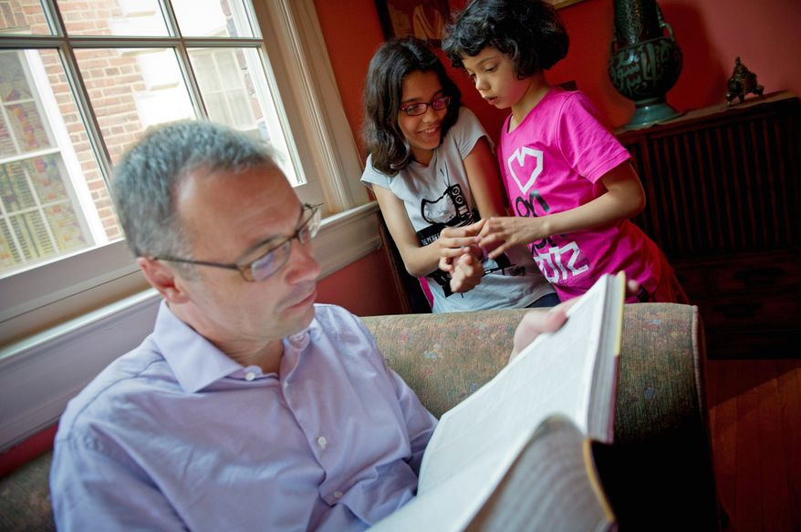 """""""I'm amazed,"""" says Michael Bennett of the spelling acumen of his daughter Tuli (center, with sister Koli). """"She took it on all by herself. I had no idea she had this talent."""" (Rod Lamkey Jr./The Washington Times)"""