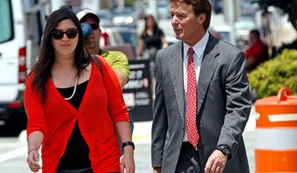 ** FILE ** John Edwards, a former presidential candidate, and daughter Cate Edwards return to federal court after a break during the sixth day of jury deliberations in Greensboro, N.C., on Friday. (Associated Press)