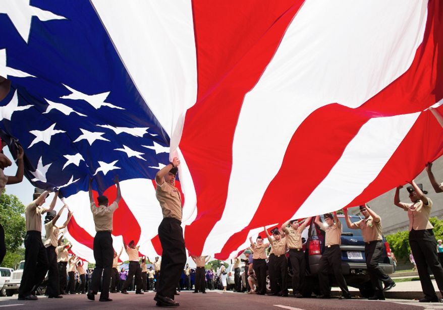 R.O.T.C students unfurl a large American flag at the start of the Memorial Day Parade on Constitution Avenue, Washington, D.C., Monday, May 28, 2012. (Andrew Harnik/The Washington Times)
