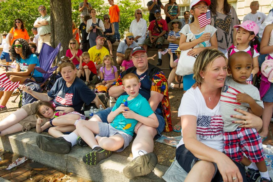 Crowds gather to watch the Memorial Day Parade along Constitution Avenue. (Andrew Harnik/The Washington Times)