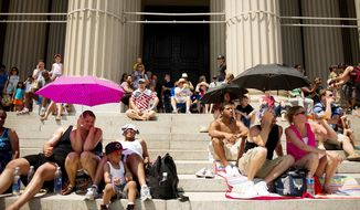 Crowds gather on the steps of the National Archives to watch the Memorial Day Parade on Constitution Avenue. (Andrew Harnik/The Washington Times) ** FILE **