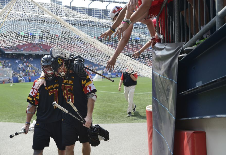 Maryland's Charlie Raffa, left, and Landon Carr console each other after their 9-3 loss against Loyola in the Division I NCAA men's lacrosse championship game at Gillette Stadium in Foxborough, Mass., Monday, May 28, 2012. (AP Photo/Gretchen Ertl)
