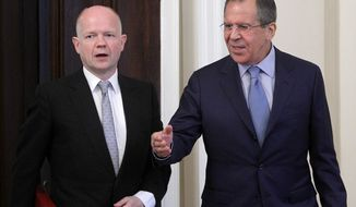 ** FILE ** Russian Foreign Minister Sergey Lavrov, right, welcomes his British counterpart William Hague during their meeting in Moscow, Russia, Monday, May 28, 2012, expected to focus on the Syria crisis. (AP Photo/Misha Japaridze)
