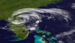 This image provided by the National Oceanic and Geographic Authority shows a satellite image of Tropical Storm Beryl as it makes landfall in Florida early Sunday, May 28, 2011. The storm made landfall in northeastern Florida, bringing drenching rains and driving winds to the southeastern U.S. coast, forecasters said. (AP Photo/NOAA)