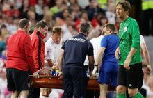 Gordon Ramsay of the Rest Of The World team, is carried from the pitch on a stretcher after a tackle by England's Teddy Sheringham, top centre left, during the Soccer Aid charity soccer match in aid of UNICEF at Old Trafford Stadium, Manchester, England, Sunday, May 27, 2012. (AP Photo/Jon Super)