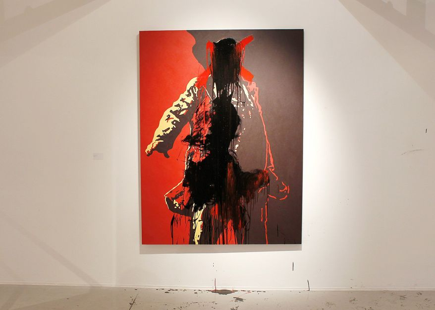 The controversial portrait of South African President Jacob Zuma painted by Brett Murray, was defaced last week while on display at the Goodman Gallery in Johannesburg. Footage shown on a national news station shows a man in a suit painting a red X over the president's genitals and then his face. Next, a man in a hoodie rubs black paint over the president's face and down the painting. Two men - one white, one black - were arrested and charged with trespassing. The painting has been removed from the gallery. (Associated Press)
