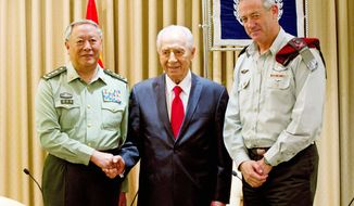 Gen. Chen Bingde, chief of the General Staff of the Chinese People's Liberation Army (left), met last week with with Israeli military chief, Lt. Gen. Benny Gantz (right). After a prolonged chill, security relations between Israel and China are warming up. (Associated Press)