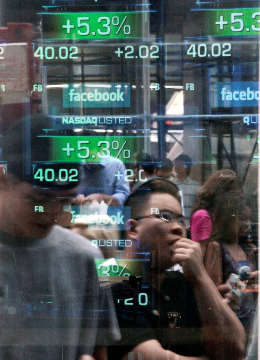 Passers-by are reflected in the window of the Nasdaq media center as they view reports of trading activity on Facebook's stock on the Nasdaq stock market in New York. The botched offering of Facebook stock has raised several troubling questions. The stock fell $3.07 to close at $28.84 on Tuesday. (Associated Press)