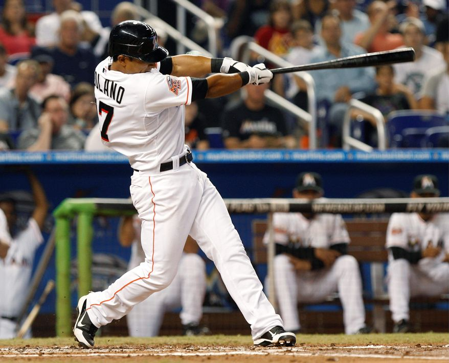 Miami Marlins' Donovan Solano follows through on a RBI single to score Giancarlo Stanton in the second inning of a baseball game against the San Francisco Giants in Miami, Saturday, May 26, 2012. (AP Photo/Lynne Sladky)