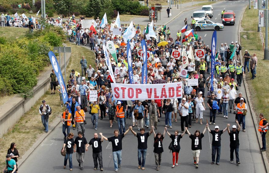 """Members of labor unions and non-governmental groups march to protest government reforms and austerity cuts in Prague, Czech Republic, Tuesday, May 22, 2012. Banner reads: """"Stop to government"""". (AP Photo/Petr David Josek)"""