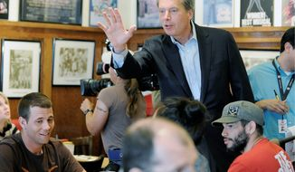 Texas Lt. Gov. David Dewhurst, a Republican candidate for the Senate, visits a restaurant in Houston on Tuesday, the day of the primary. Mr. Dewhurst touts his experience in the Air Force, the CIA and in business. (Associated Press)