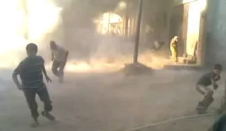 A frame grab from an amateur video provided by Syrian activists on Monday, May 28, 2012, purports to show the massacre in Houla on Friday that killed more than 100 people, many of them children. (AP Photo/Amateur video via AP Video)