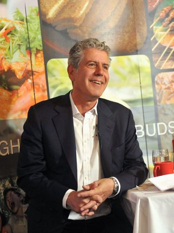 Anthony Bourdain has left the Travel Channel for CNN, where he'll host a new prime-time Sunday program. (Images for Singapore Tourism Board via Associated Press)