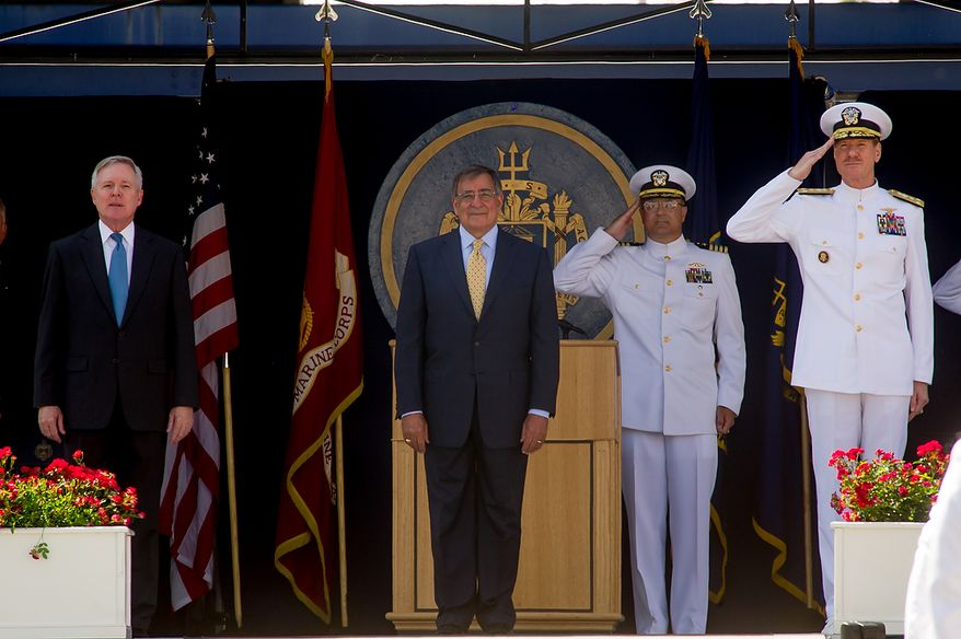 Secretary of the Navy Ray Mabus (left) and Secretary of Defense Leon E. Panetta (second from left) stand on the main stage at the beginning of graduation ceremonies for the U.S. Naval Academy's class of 2012 at the Navy-Marine Corps Stadium in Annapolis on Tuesday, May 29, 2012. (Andrew Harnik/The Washington Times)