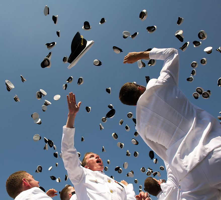 The U.S. Naval Academy's class of 2012 tosses their hats in the air as they graduate at the Navy-Marine Corps Stadium, Annapolis, Md., Tuesday, May 29, 2012. (Andrew Harnik/The Washington Times)