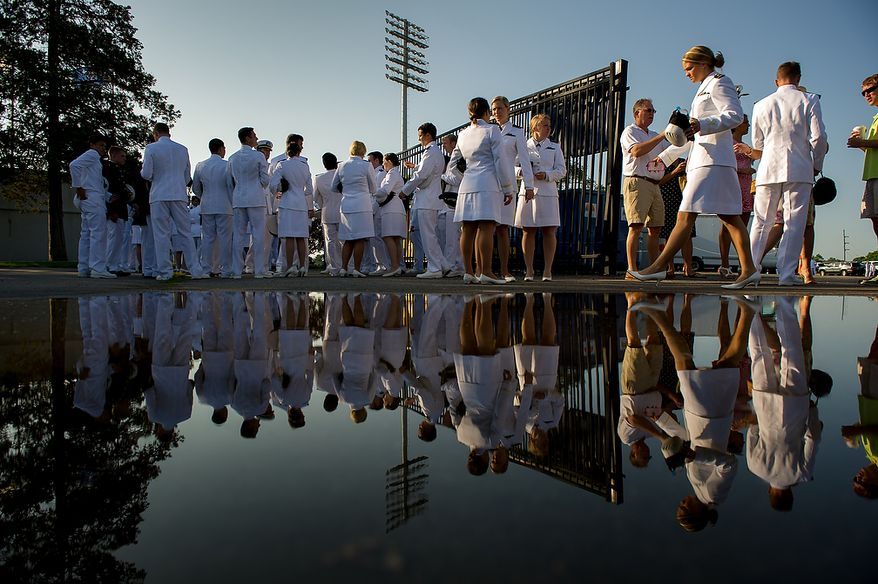 4th Class Midshipmen with the U.S. Navy Academy's class of 2012 wait for their graduation ceremony to begin at the Navy-Marine Corps Stadium, Annapolis, Md., Tuesday, May 29, 2012. (Andrew Harnik/The Washington Times)