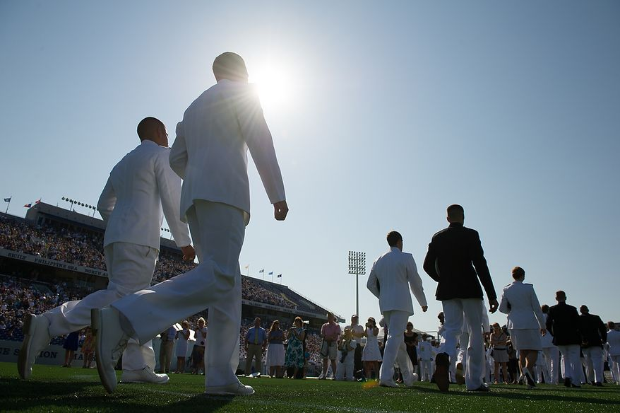 The U.S. Navy Academy's class of 2012 enters onto the field for the start of their graduation ceremony at the Navy-Marine Corps Stadium, Annapolis, Md., Tuesday, May 29, 2012. (Andrew Harnik/The Washington Times)