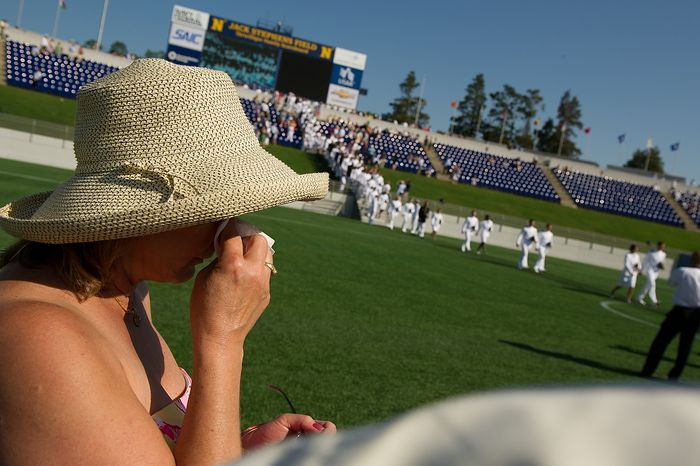 Mary Heimerl of Holand, N.J. wipes tears from her eyes as their son John and the rest of the U.S. Naval Academy's class of 2012 enters before their graduation ceremony at the Navy-Marine Corps Stadium, Annapolis, Md., Tuesday, May 29, 2012. (Andrew Harnik/The Washington Times)