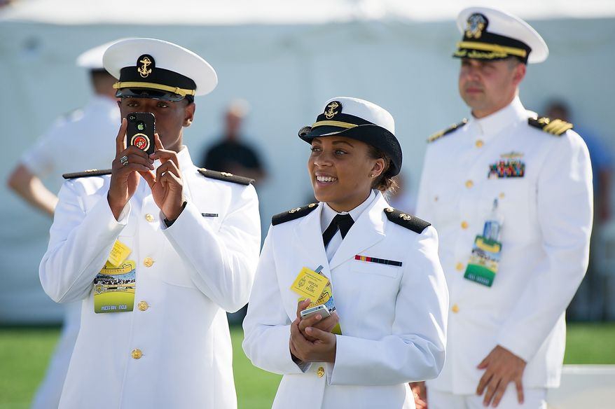 Midshipmen watch as the U.S. Navy Academy's class of 2012 enters onto the field for the start of their graduation ceremony at the Navy-Marine Corps Stadium, Annapolis, Md., Tuesday, May 29, 2012. (Andrew Harnik/The Washington Times)