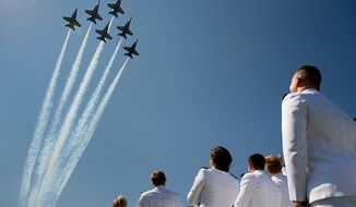 **FILE** The U.S. Navy's Blue Angels fly over the graduation ceremony for the U.S. Navy Academy's class of 2012 at the Navy-Marine Corps Stadium, Annapolis, Md., on May 29, 2012. (Andrew Harnik/The Washington Times)