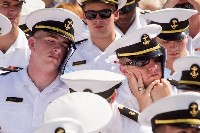Midshipmen shield themselves from the sun in the stands during the graduation ceremony for the U.S. Naval Academy's class of 2012 at the Navy-Marine Corps Stadium, Annapolis, Md., Tuesday, May 29, 2012. (Andrew Harnik/The Washington Times)