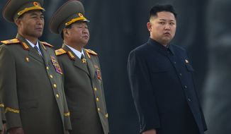 North Korean leader Kim Jong-un (right) stands next to senior military leaders during a ceremony in honor of his father, Kim Jong-il, and grandfather, Kim Il-sung, in Pyongyang, North Korea, on Friday, April 13, 2012. (AP Photo/David Guttenfelder)