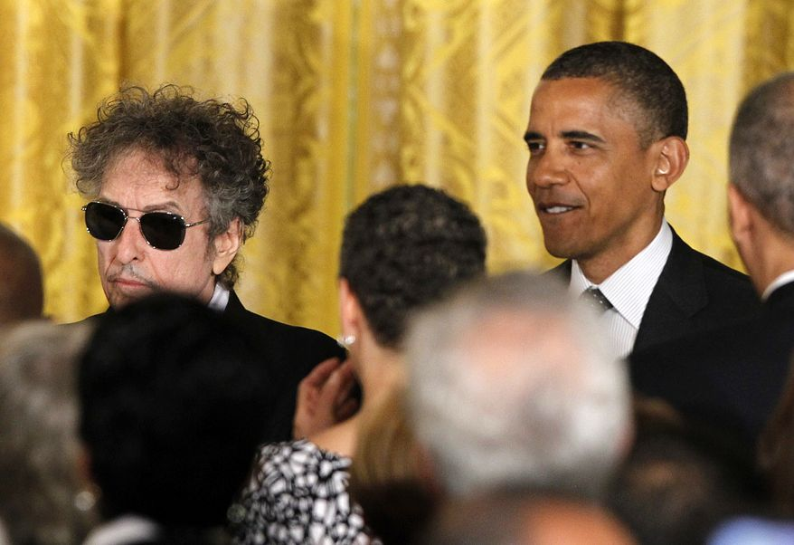 President Obama stands May 29, 2012, with rock legend Bob Dylan at the White House, where the president presented Dylan with a Medal of Freedom. (Associated Press)