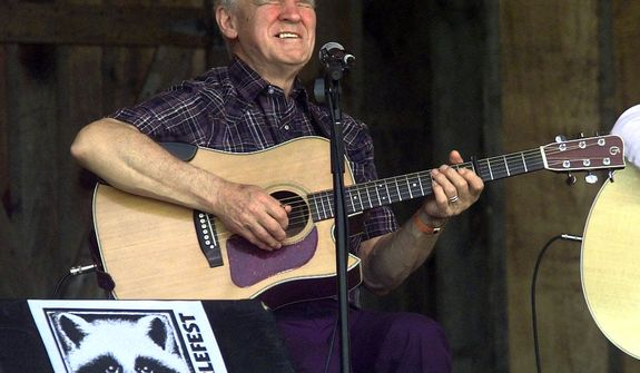 **FILE** Master flatpicker Doc Watson performs April 28, 2001, at the annual Merlefest at Wilkes Comunity College in Wilkesboro, N.C. Watson, the Grammy-award winning folk musician whose lightning-fast style of flatpicking influenced guitarists around the world for more than a half-century, died May 29, 2012, at a hospital in Winston-Salem. He was 89. (Associated Press)