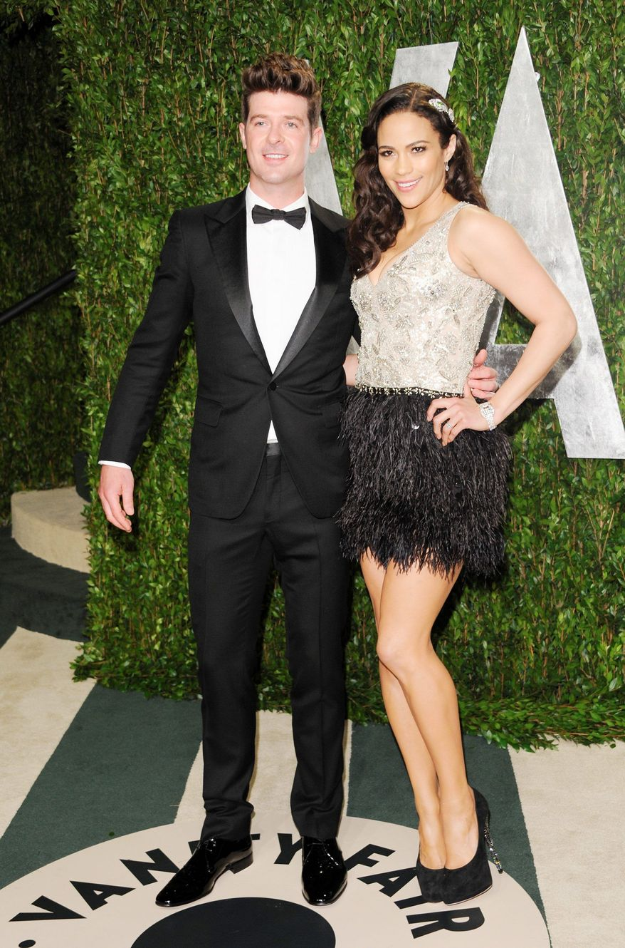 Robin Thicke and his wife, Paula Patton, attended the Vanity Fair Oscar party in February. She sang on an album he produced. (Associated Press)