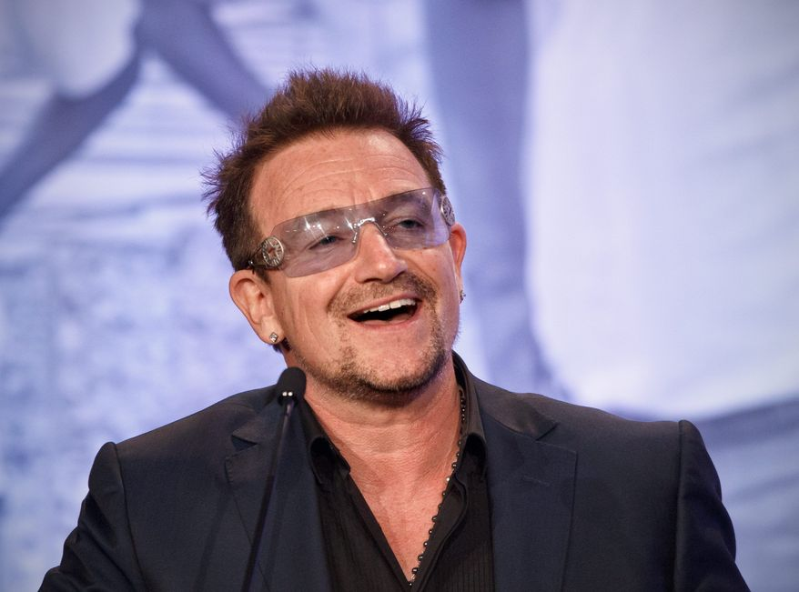 Bono will present Myanmar opposition leader Aung San Suu Kyi with Amnesty International's highest honor next month when she visits Dublin a day after she collects her 1991 Nobel Peace Prize in Oslo. (Associated Press)