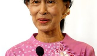 """""""It's so rare to see grace trump military might, and when it happens we should make the most joyful noise we can,"""" Bono says of Mrs. Suu Kyi, who spent 15 of the past 24 years and is now a member of Parliament. (Associated Press)"""