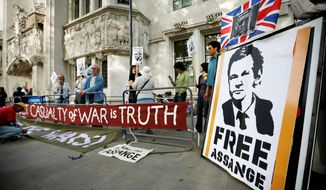 Supporters of WikiLeaks founder Julian Assange demonstrate Wednesday in London outside Britain's Supreme Court, prior to its ruling greenlighting Mr. Assange's extradition to Sweden. (Associated Press)