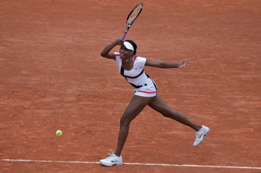 Venus Williams was bounced by Agnieszka Radwanska in straight sets in the French Open. On Tuesday, sister Serena was eliminated in the first round for the first time in a Grand Slam tournament. (Associated Press)