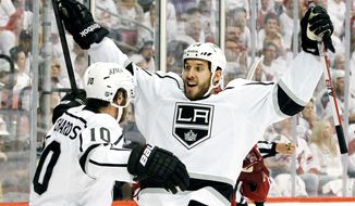Dwight King has scored five goals in 14 postseason games in Los Angeles' march to the Stanley Cup Final. He scored five regular-season goals in 27 games. Brother D.J. (right) has had a tougher going in the NHL as an enforcer for the Capitals. (Associated Press)