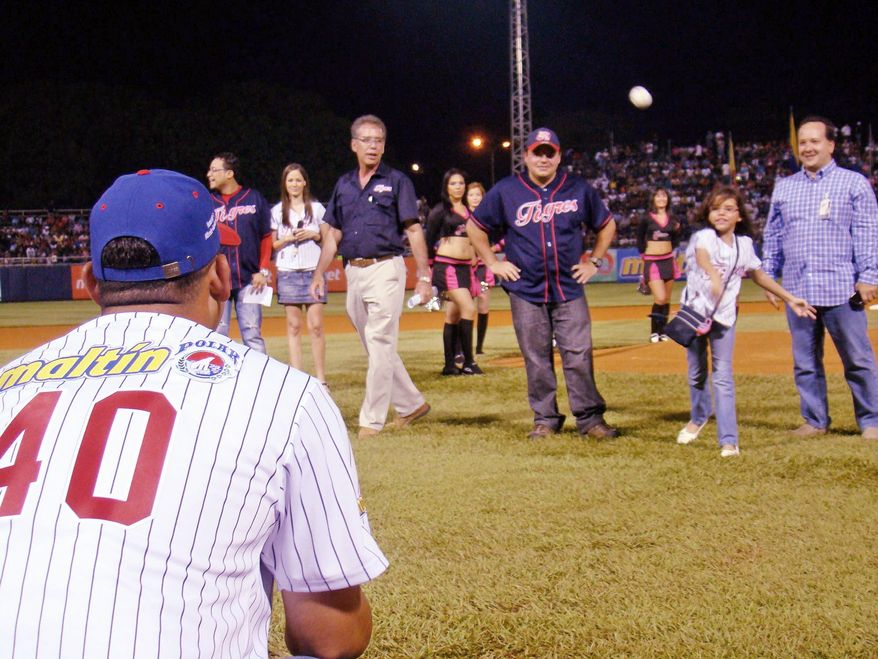 Vicky Cabrera, throwing out the first pitch on Opening Day of the Venezuelan league in October, was 11 when she was found to be suffering from a congenital heart defect. She's had two surgeries, one in her native country and one in Miami, and throughout her ordeal has been a source of strength to Nationals catcher Wilson Ramos. She now faces a third major surgery. (Provided by Marfa Mata)