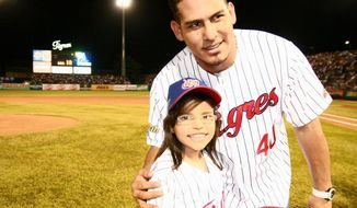 Vicky Cabrera and Nationals catcher Wilson Ramos after Vicky threw out the first pitch for the Tigres de Aragua. (Provided by Marfa Mata)