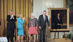 President Bill Clinton and first lady Hillary Rodham Clinton applaud as former President George H.W. Bush and former first lady Barbara Bush stand near the presidential portrait of Mr. Bush at its unveiling at the White House in 1995. A portrait of Mrs. Bush was unveiled as well. (Associated Press)