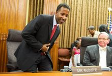 Kenyan McDuffie, the newly elected D.C. councilman in Ward 5, tries out his new seat on the dais in the council chamber room at the Wilson Building in Washington, D.C. after being sworn in on Wednesday, May 30, 2012. McDuffie was elected May 15 in a special election to replace Councilman Harry Thomas, who plead guilty to funneling some $350,000 in funds intended for city children. (Barbara L. Salisbury/The Washington Times)