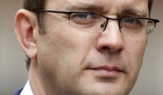 **FILE** Andy Coulson, former editor of the News of the World tabloid and former director of communications for British Prime Minister David Cameron, arrives at the High Court in London on May 10, 2012, to appear at the Leveson inquiry into the media phone-hacking scandal. (Associated Press)