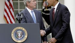 ** FILE ** President Obama shakes hands with former President George W. Bush in the Rose Garden at the White House in Washington on Jan. 16, 2010. (AP Photo/Pablo Martinez Monsivais)