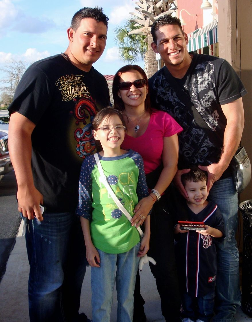 Nationals catchers Carlos Maldonado (left) and Wilson Ramos pose with Vicky Cabrera, 13, mother Marfa Mata and Enrique Jose Lecuona Mata, 4. Ramos is a close friend of the family and has been instrumental in helping with Vicky's medical expenses. (Provided by Marfa Mata)