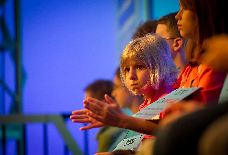 Six year-old Lori Anne C. Madison of Woodbridge, Va., waits in her seat for her chance to spell her word during the preliminary rounds of the 2012 Scripps National Spelling Bee at the Gaylord National Resort and Convention Center in National Harbor, Md., Wednesday, May 30, 2012. This year, 278 spellers from around the United States and all walks of life will compete for the title of 2012 Scripps National Spelling Bee champion. Lori Anne spelled her word, dirigible, correctly. (Rod Lamkey Jr/The Washington Times)