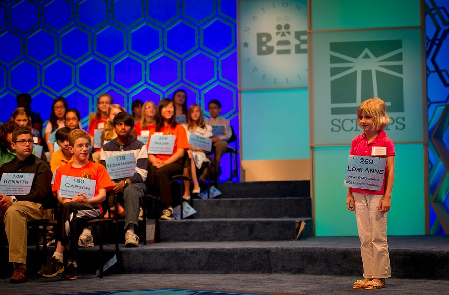 Six year-old Lori Anne C. Madison of Woodbridge, Va., waits on stage for her chance to spell her word during the preliminary rounds of the 2012 Scripps National Spelling Bee at the Gaylord National Resort and Convention Center in National Harbor, Md., Wednesday, May 30, 2012. This year, 278 spellers from around the United States and all walks of life will compete for the title of 2012 Scripps National Spelling Bee champion. Lori Anne spelled her word, dirigible, correctly. (Rod Lamkey Jr/The Washington Times)