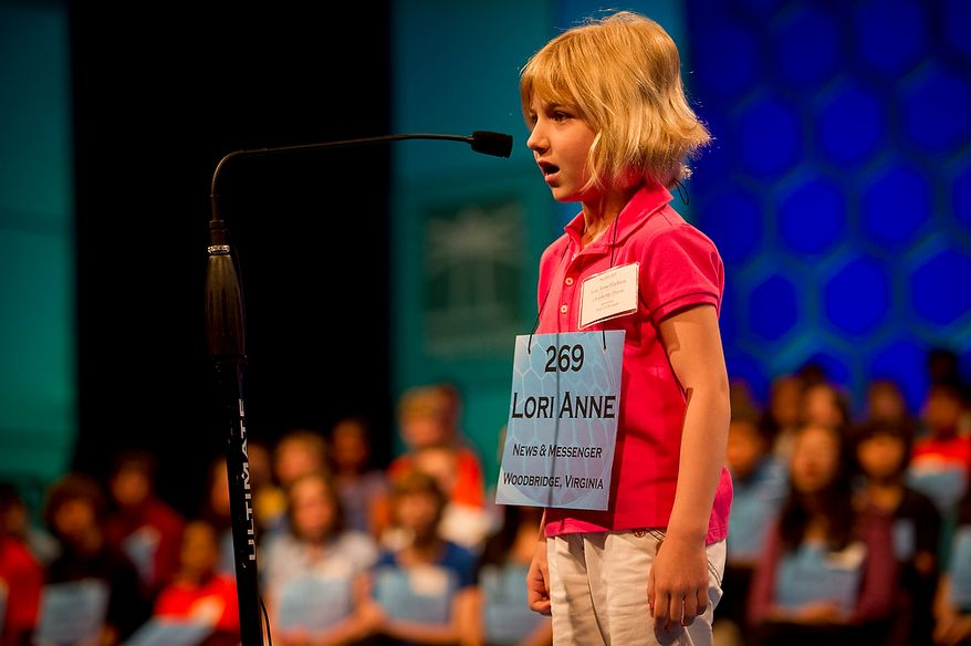 Six year-old Lori Anne C. Madison of Woodbridge, Va., works on spelling her word during the preliminary rounds of the 2012 Scripps National Spelling Bee at the Gaylord National Resort and Convention Center in National Harbor, Md., Wednesday, May 30, 2012. This year, 278 spellers from around the United States and all walks of life will compete for the title of 2012 Scripps National Spelling Bee champion. Lori Anne spelled her word, dirigible, correctly. (Rod Lamkey Jr/The Washington Times)