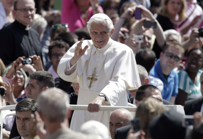 Pope Benedict XVI waves as he arrives for his weekly audience in St. Peter's Square at the Vatican on Wednesday, May 30, 2012. (AP Photo/Riccardo De Luca)