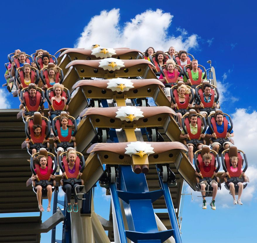 This undated photo shows riders on the Wild Eagle, a new 210-foot tall coaster that opened in March at Dollywood in Pigeon Forge, Tenn. The coaster is one of a number of new attractions opening at theme parks around the country this season. (AP Photo/Dollywood, Steven Bridges)