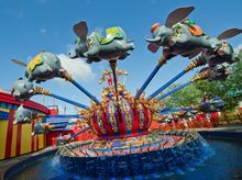 ** FILE ** Dumbo takes youngsters for a ride in Walt Disney World's Fantasyland area. (Associated Press)
