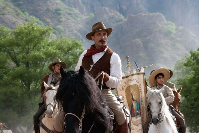 """In """"For Greater Glory,""""Andy Garcia plays a general who sides with Catholics in the Cristero War of the 1920s over the Mexican government's restrictions on worship. With him, holding the flag, is Mauricio Kuri. The mostly Latino cast speaks in English. (ARC Entertainment via Associated Press)"""